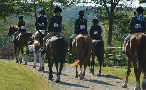 Riders at a Stonewall Stables horse show