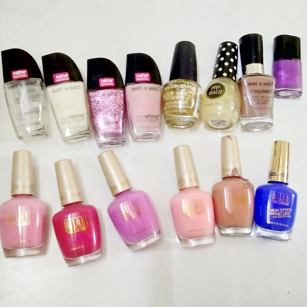 Bunch of nail polishes and finishes in various color and glitter - bold and neutral colors for work and party