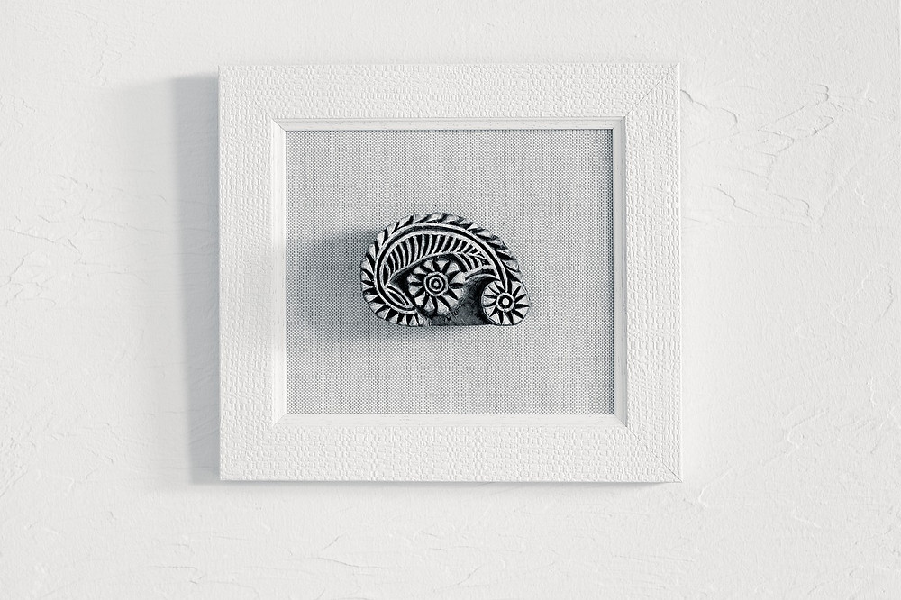 framed decorative wooden block in grey black and neutral colors