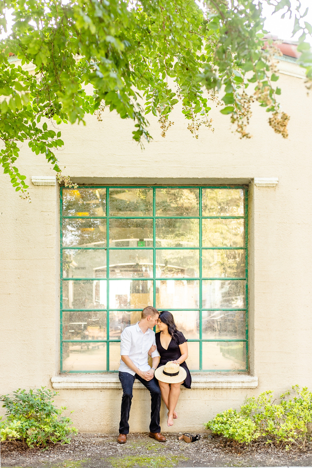 A couple does their engagement session at Tulare Public Library by Ashley Norton