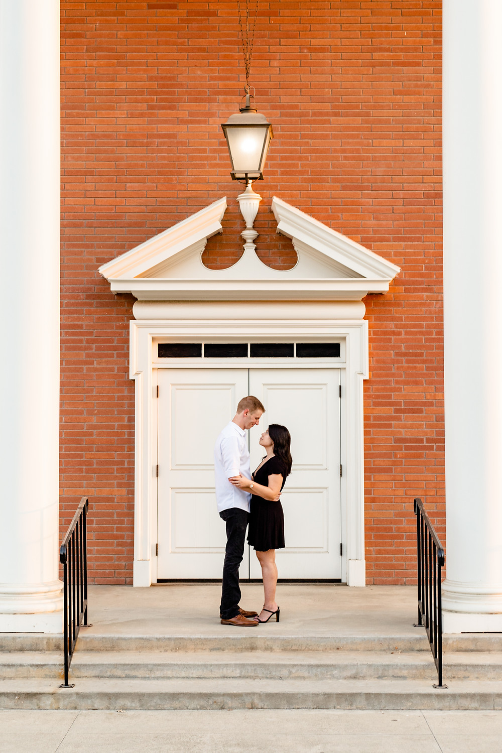 A couple does their engagement session in front of a church with Ashley Norton Photography in Visalia, CA.