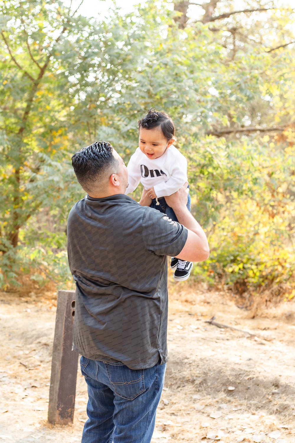 A family does a family portrait session in Fresno, CA.