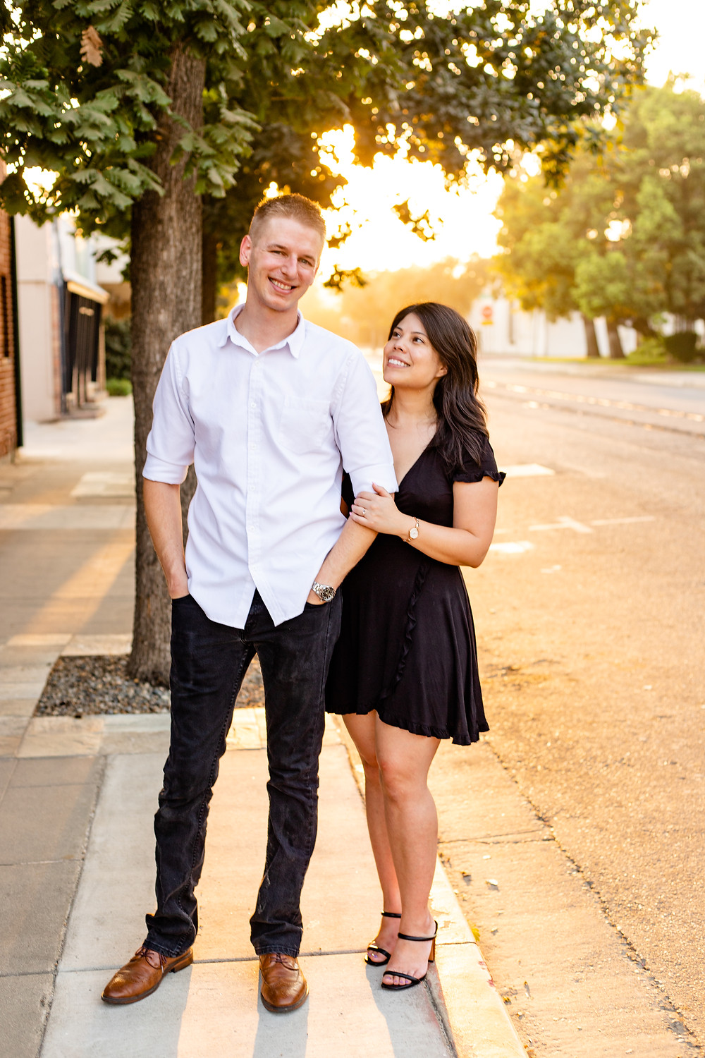 A couple does their golden hour engagement session with Ashley Norton Photography in Visalia, CA.