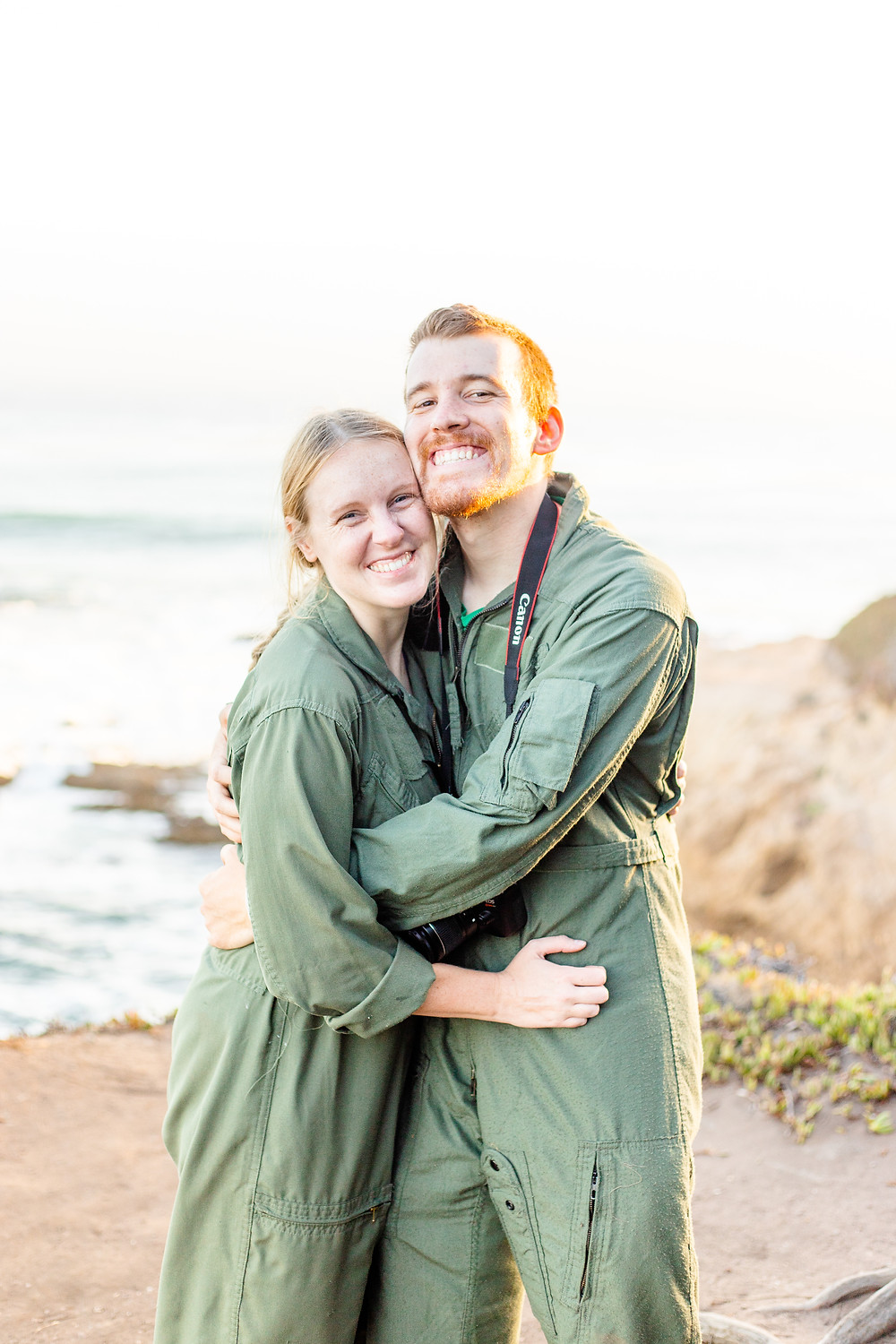 A photographer and her second shooter based in Fresno, CA hold each other close for a photo.