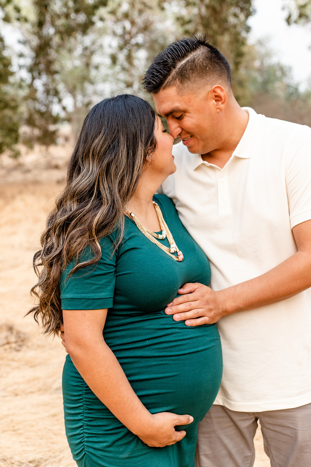 A family does their maternity session with Ashley Norton Photography in the Central Valley.