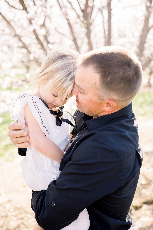 Clovis family photographer Ashley Norton Photography in blossom