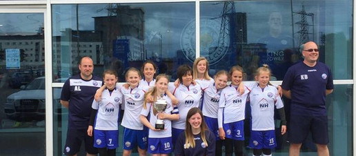 Under 12's lift the trophy
