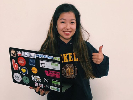 Young woman holds the CODE for success in the world of engineering