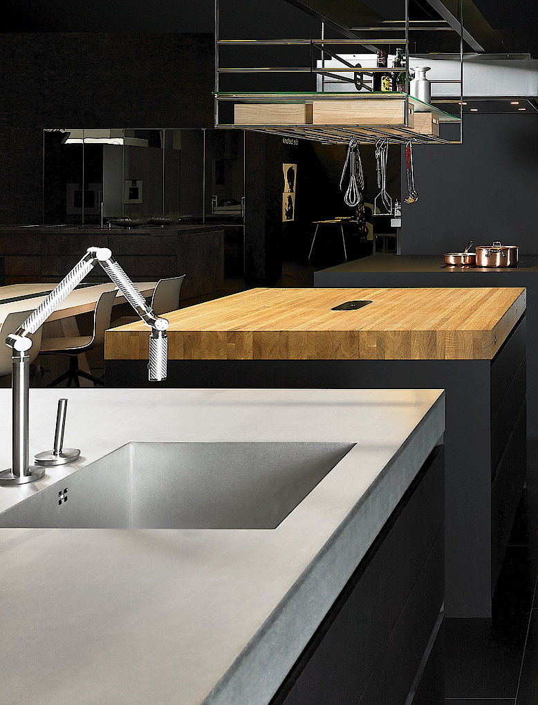 Island in soft feel matt graphite lacquer, worktops solid oak, grapite laminatre and silverTouch stainelss steel