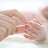 Mother Holding Baby Finger
