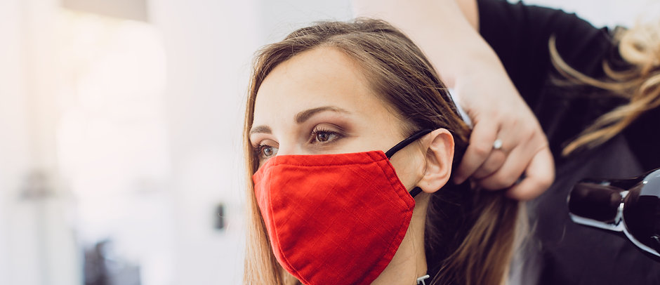 Woman wearing red face mask getting fres