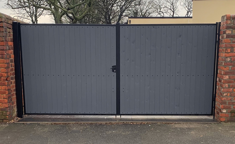 Driveway Gates with Wood Inserts - View more on Instagram