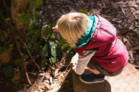 little-girl-exploring-the-nature-through