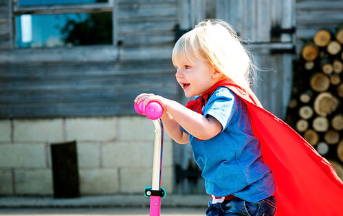 superhero-baby-boy-using-scooter-adorabl