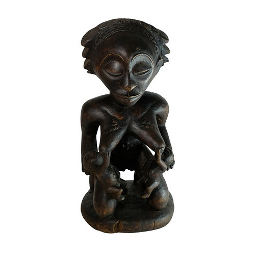 Carved wooden fertility statue