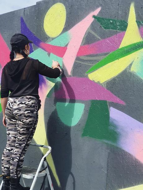 Female Urban Graffiti Artist Spray Paint