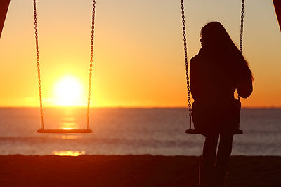 Single Woman looking at the sunset on swing needing lgbtqia counseling in madison, wi for LGBTQAI therapy 53703 and online counseling in Wisconsin with Golden Vibes Counseling Center