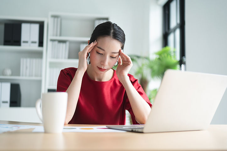 Stress asian women in red shirt | online anxiety treatment | online depression treatment | online relationship therapy | online therapy in Houston, TX | online therapist | houston, tx 776027 | Dallas, TX 75226 | San Antonio 78201