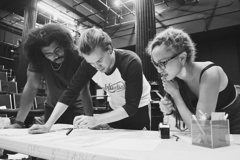 Rafael Casal and Daveed Diggs advising with Bars Workshop member on revisions at The Public Theater.