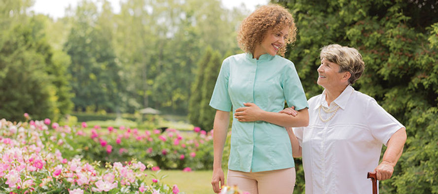 A-caregiver-and-her-patient-walking-in-t