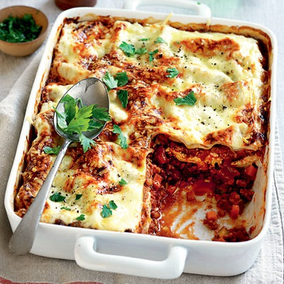 Beef and mozzarella lasagne with steamed vegetables