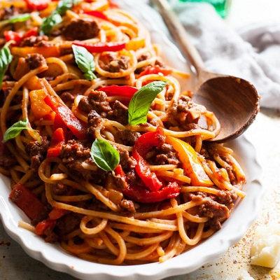 Minted lamb ragu on spaghetti, with steamed vegetables