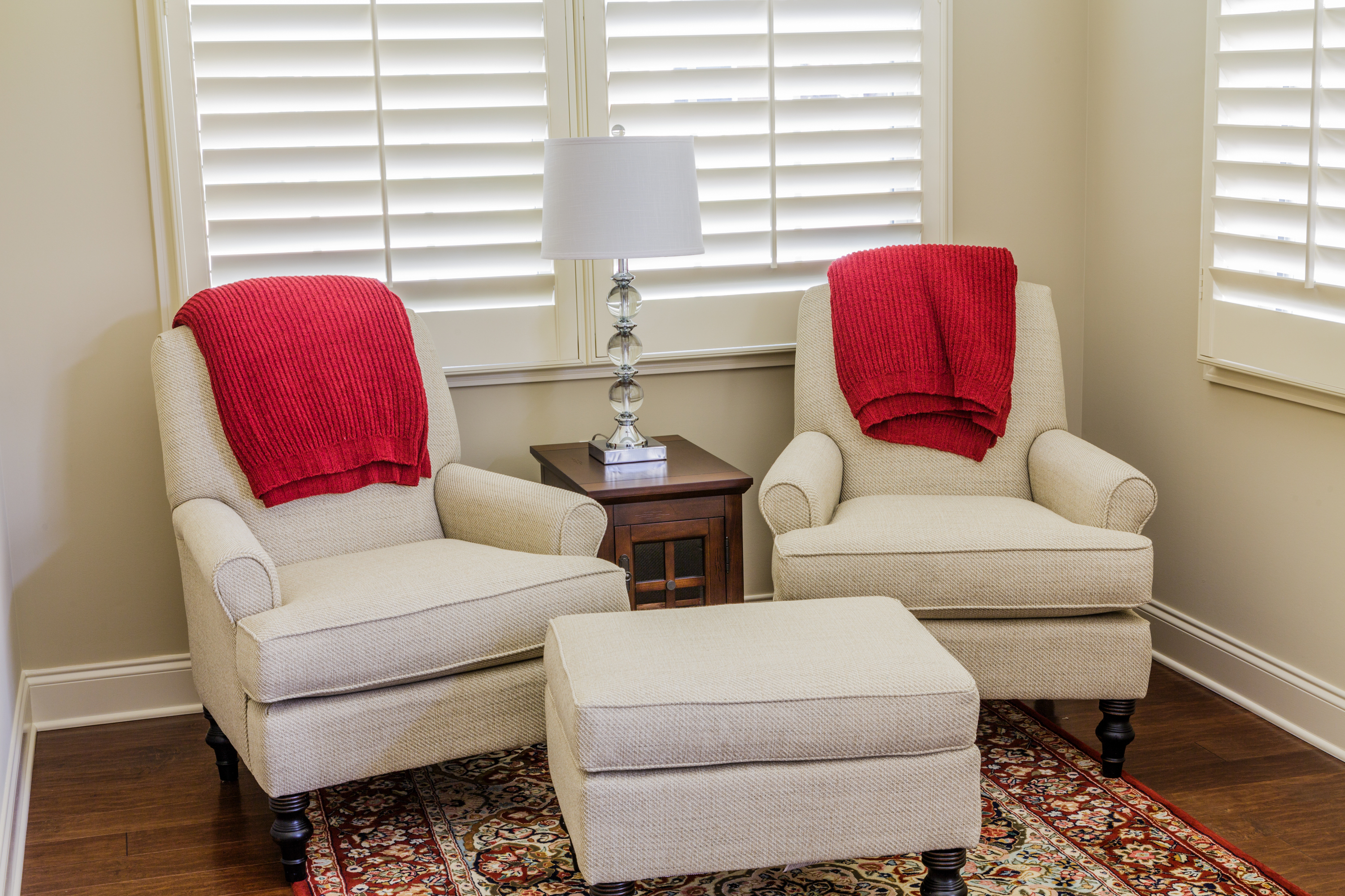 White Chairs with Red Throws in Sun Room
