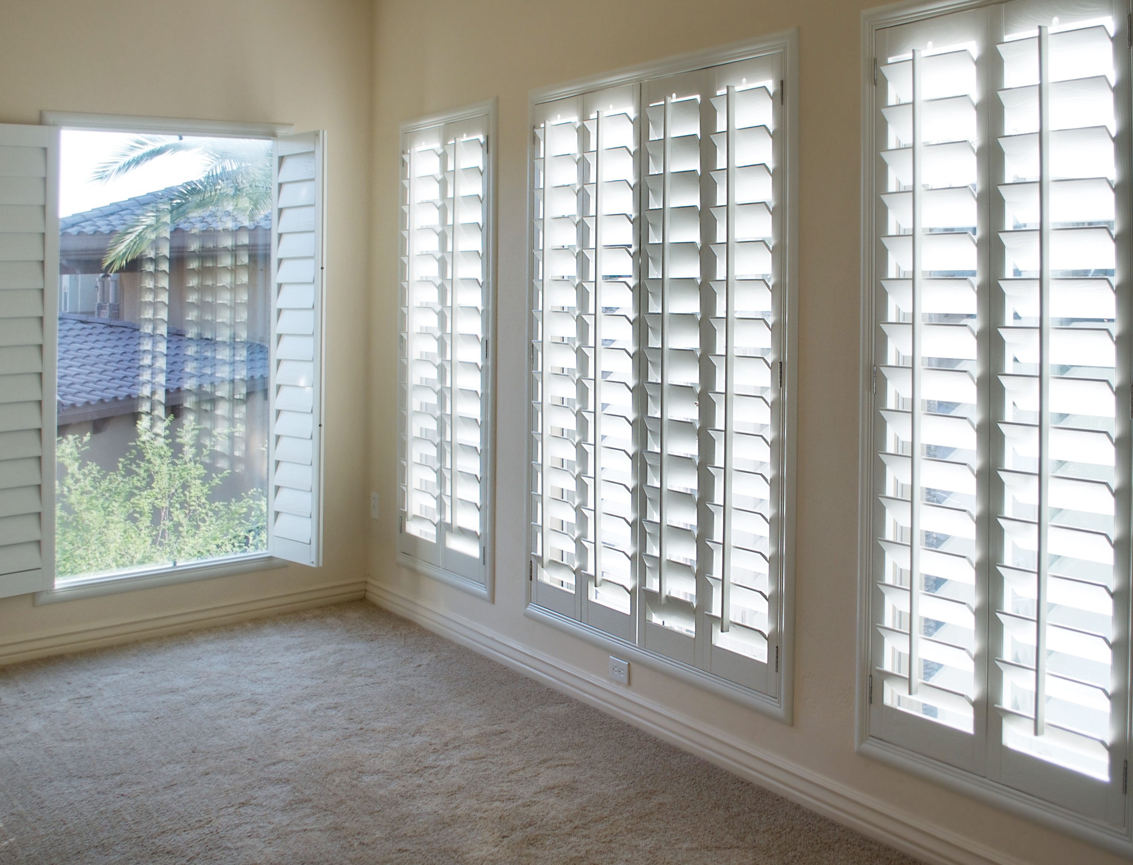White plantation style wood Shutters for