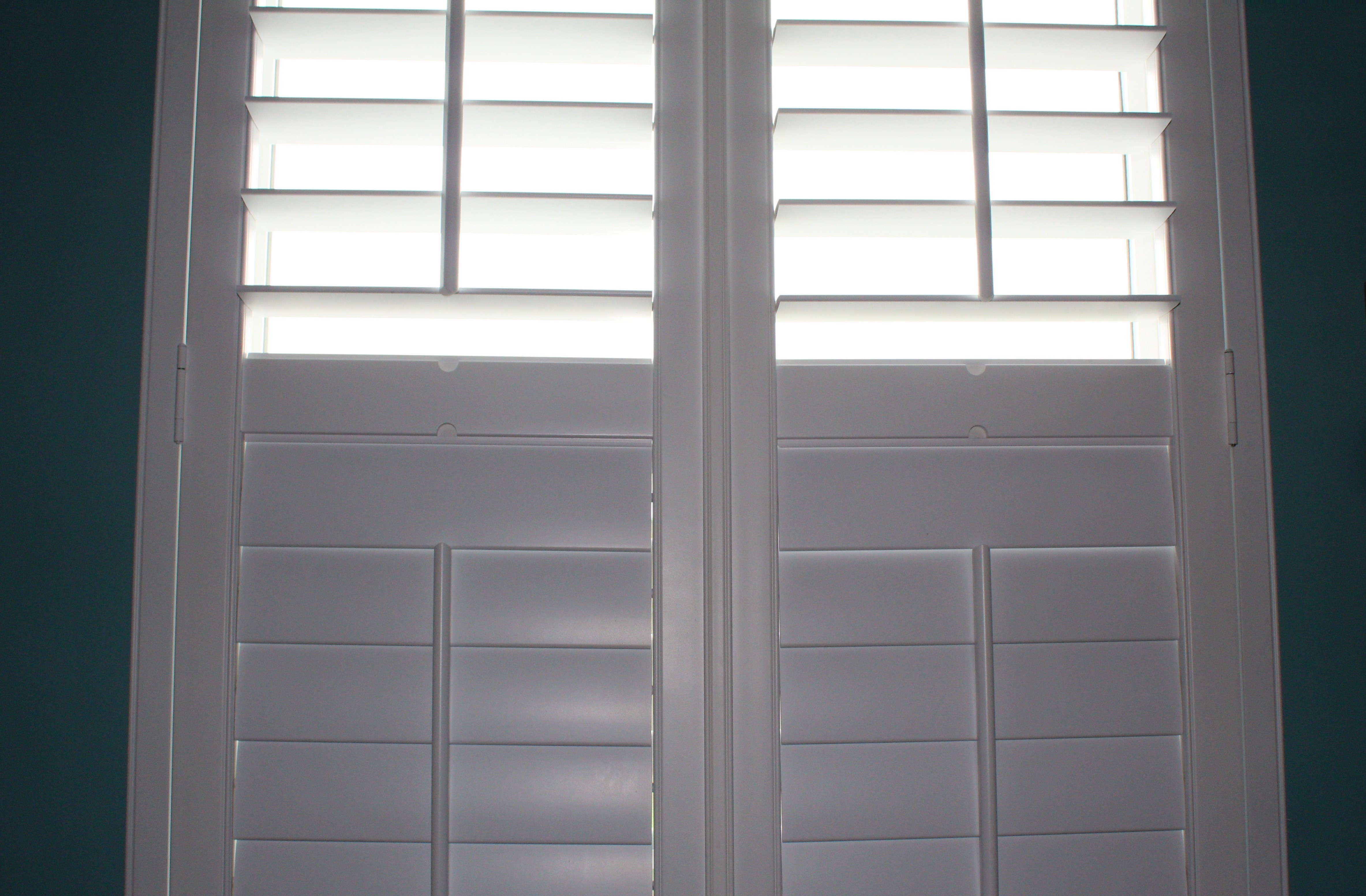 white plantation shutters open and close