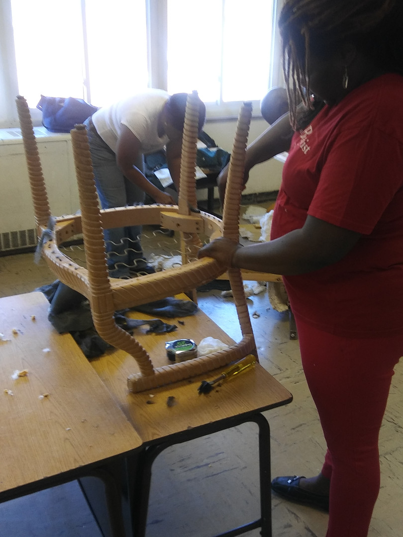 Chairs being stripped2.jpg