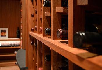 Wine Bottles on its Side in a Wine Cellar