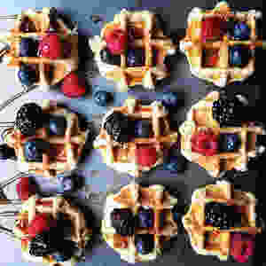 bourbon syrup drizzled Belgian waffles, organic farm fresh berries