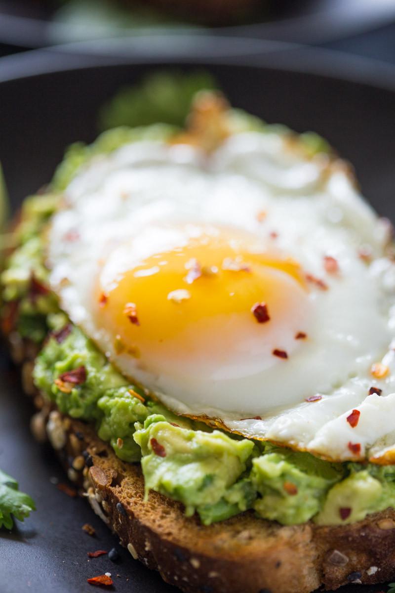 Avocado toast, farm fresh egg, chili flake