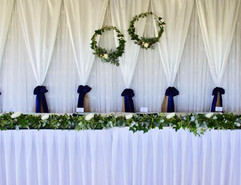 bridal table with a lush garland