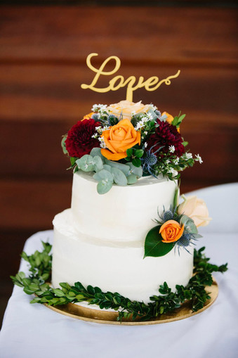 Wedding cake flowers in sunny colours