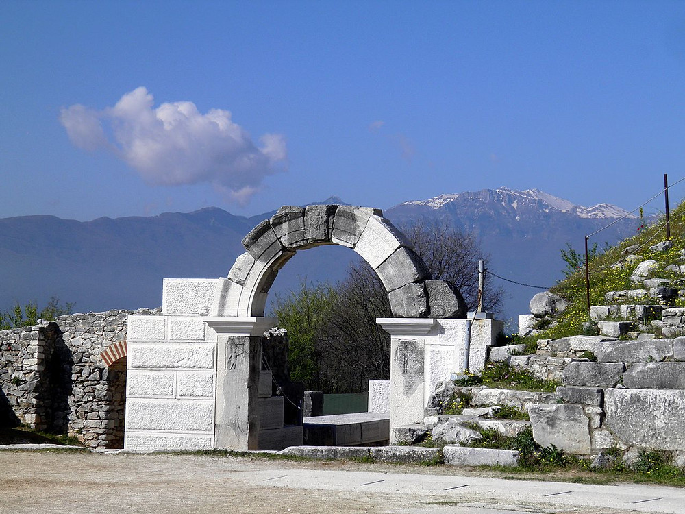 By Carole Raddato from FRANKFURT, Germany - West parodos of the Ancient Theatre with the Pangaion mountain in the background, PhilippiUploaded by Marcus Cyron, CC BY-SA 2.0, https://commons.wikimedia.org/w/index.php?curid=30145196