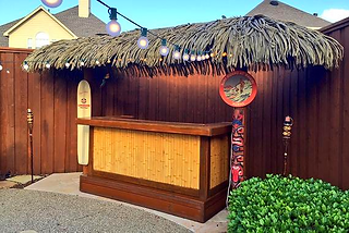 Custom made tiki bat with synthetic thatch
