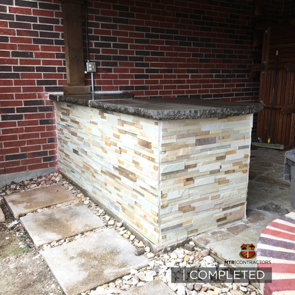 Outdoor kitchen and grill restoration in