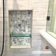 Custom shower niche in a North Dallas ba