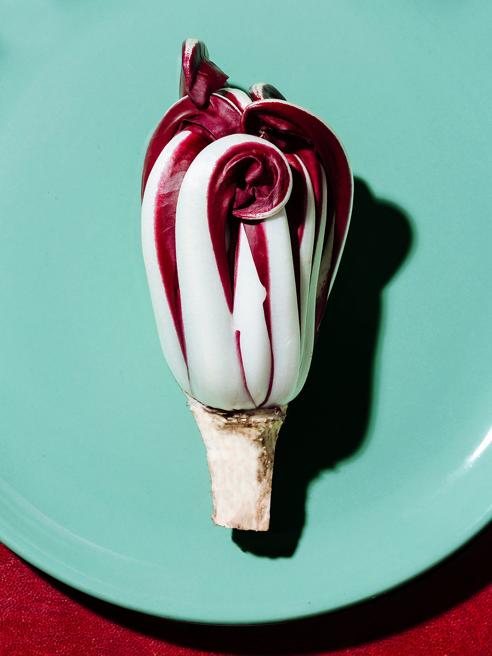 A purple-white radicchio on a plate