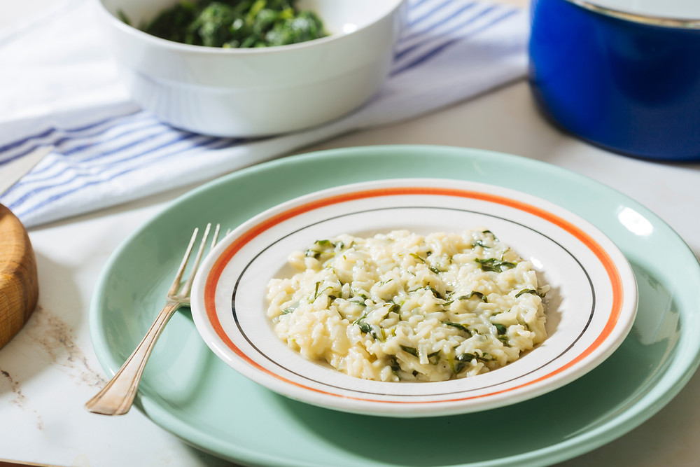 Lemon spinach risotto on a round plate.