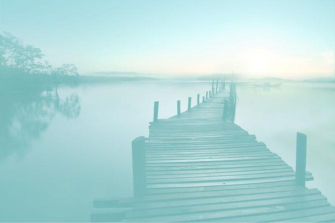 Long calm dock on a beautiful slightly foggy morning