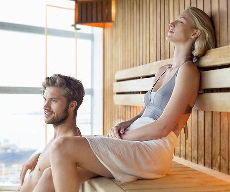 Couple enjoying sauna.