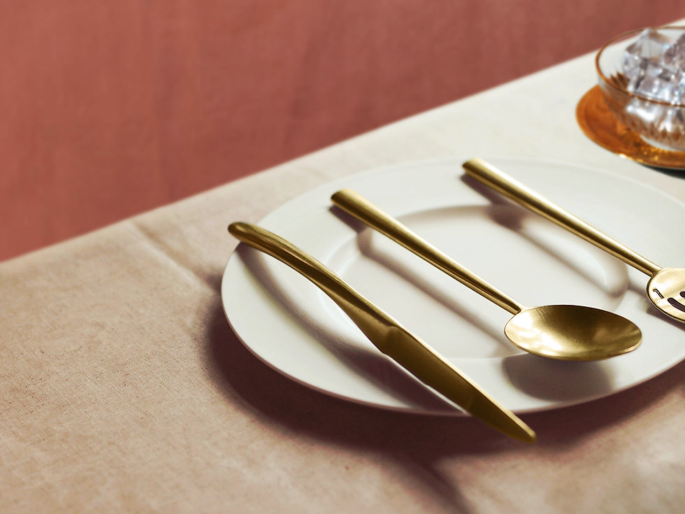 Golden silverware on a white plate