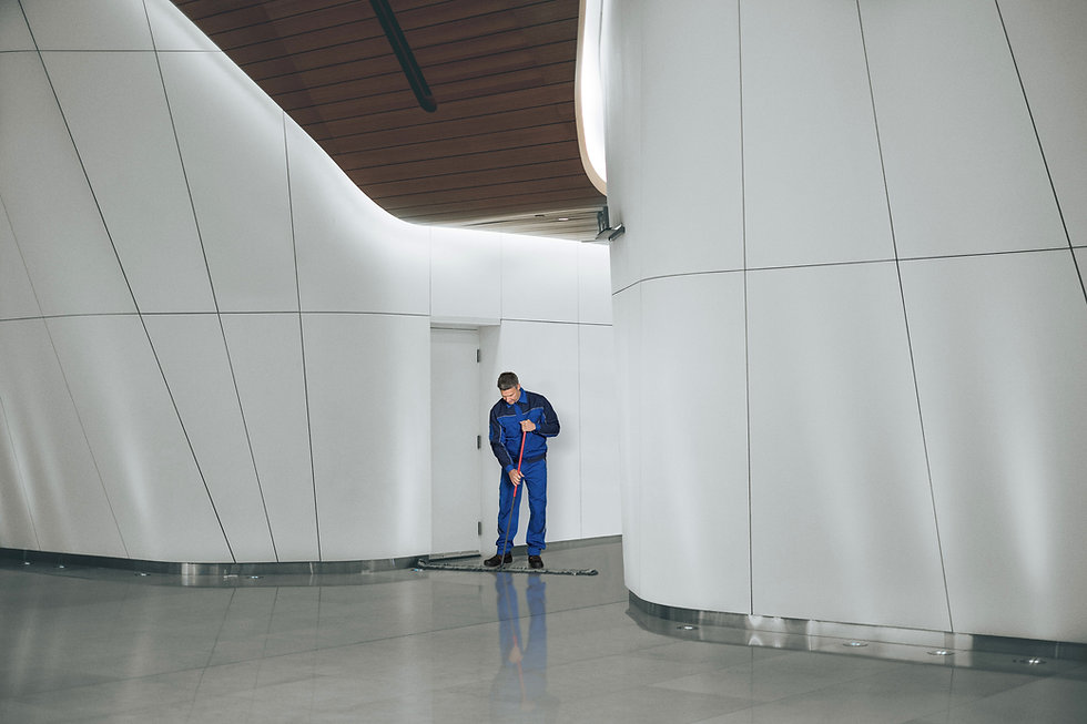 Man cleaning commercial building