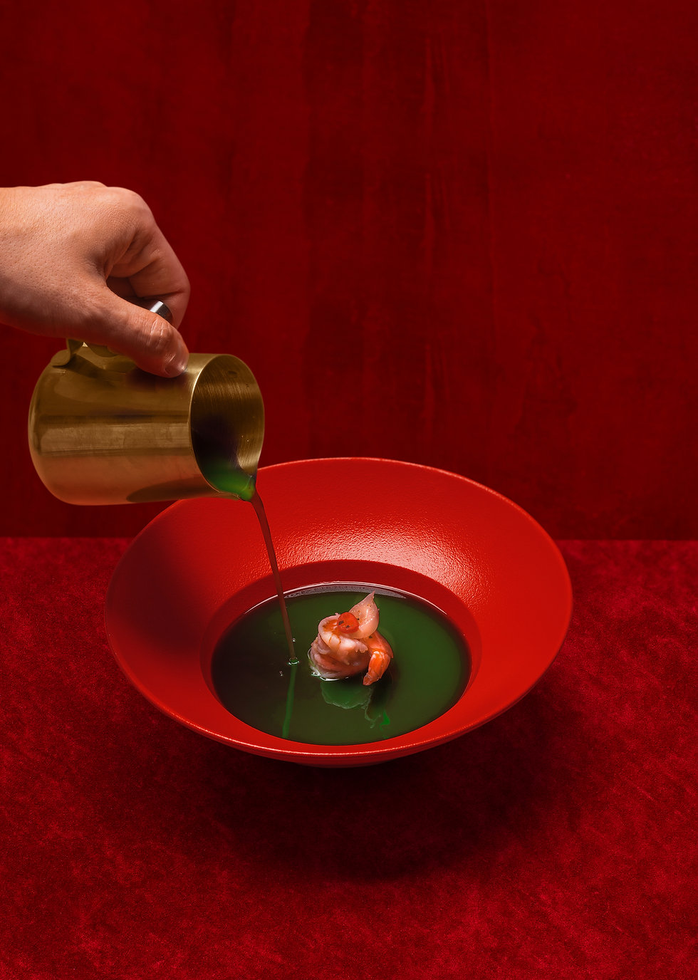 sauce being poured into a bowl