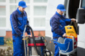 Two men loading cleaning materials