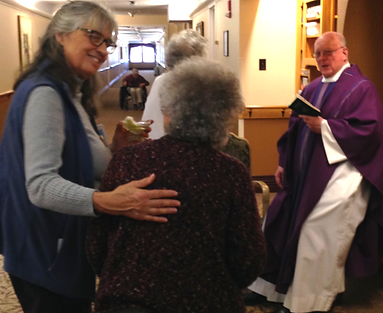 S.Rose-Fr.Charlie with resident Maria S.