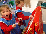 preschoolers painting and sharing