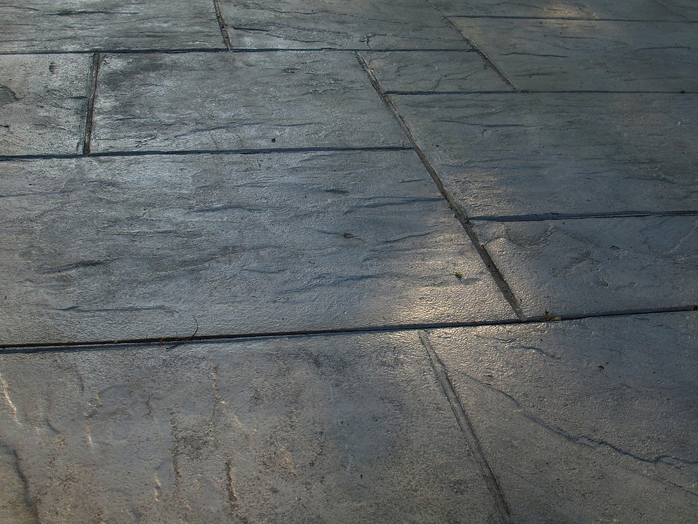 Old faded concrete pavers